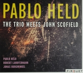 The trio meets John Scofield