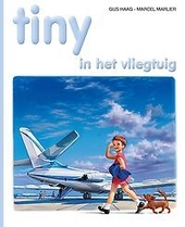 Tiny in het vliegtuig